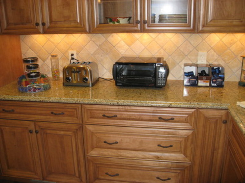 how to install a kitchen cabinet on the wall signature kitchen amp bath st louis tumbled marble backsplash 9909