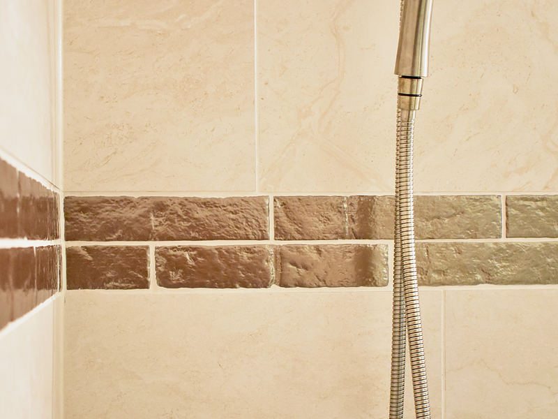 Wow copper accent tile in shower